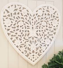 white heart carved wooden wall panel