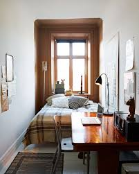 Design Dozen: 12 Clever Space-Saving Solutions for Small Bedrooms A deep  window sill can do nightstand duty in a narrow room.
