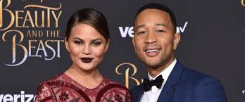 john legend said he s so proud of wife chrissy teigen s essay on photo model chrissy teigen and singer john legend arrive at the los angeles premiere of