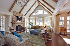fascinating craftsman living room chairs furniture: craftsman living room with high ceiling and sphere chandeliers