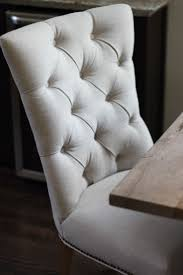 dining items upholstered settee tufted wing