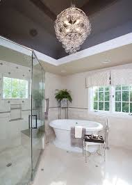 bathrooms contemporary master bathroom with glass chandelier above cornered bathtub and modern vanity cabinet bathroom