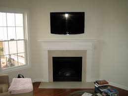 corner stone fireplace with tv above