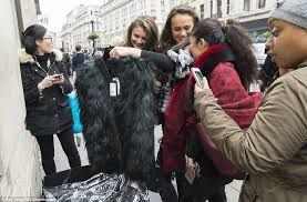 bonding time a woman who picked up the fur coat in an emerald shade can