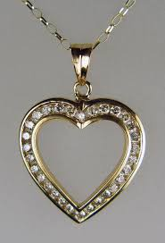 1ct diamond heart pendant in 9ct yellow gold 1ct of round brilliant cut diamonds channel
