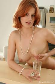 Redhead milks huge breasts