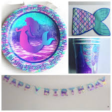 Image of Mermaid party supplies. Plates, cups, napkins and matching garland