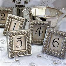 wedding place cards photo frames unique details in the decor table numbers in silver boules mini