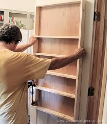 Build your own affordable pantry door organizer with some wood and a few basic tools. Beautiful Affordable Pantry Door Organizer ·
