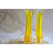 pair of yellow and clear swung glass vases