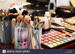 table set up of a makeup artist with diffe cosmetics tools brushes