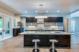 Contemporary Kitchen With Meridian Gray Quartz Counter Island With Chrome Bar  Stools And Brushed Beige Marble