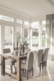 dining room table with fabric chairs simplistic interieur