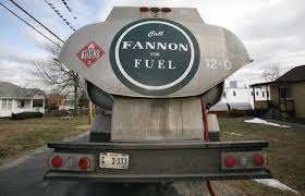 A heating oil delivery truck drives through Alexandria, Va., in this 2010  file photo. Of all four fuels, oil is the most costly way to heat a home  this ...