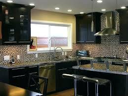 lighting above kitchen cabinets for espresso cabinets mosaic glass tile with espresso kitchen cabinets also modern