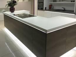 best kitchen designs uk. modern kitchen island design in a u-shape with mirrored plinth and integrated lighting. best designs uk