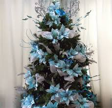 Still in the initial stages of decorating just with turquoise poinsettias,  silver and blue picks. No ornaments yet and it looks full already.