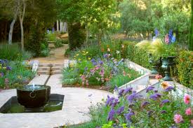 home entrance accented by pond