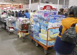 costco s quarterly profit tops estimates on tax benefit todayonline shoppers wait to pay in costco in fairfax virginia photo reuters