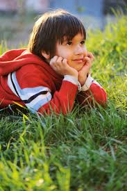 little cute boy laying on morning summer gr with natural beautiful light premium photo