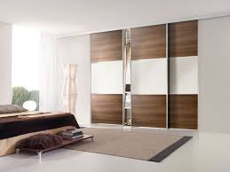 hide 3 panel sliding closet doors in a living room home decoration ideas