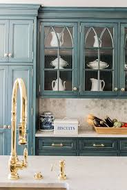 blue cabinets brass hardware
