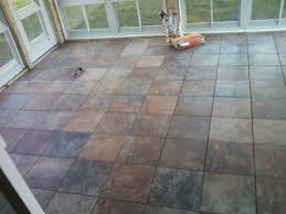 7 41pm all of the tiles were cut all except the ones on the edges were adhered