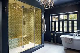 glamorous chandelier holds its own in this elegant bathroom design rich interiors