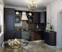 rich espresso cabinets give this small european kitchen a luxurious feel