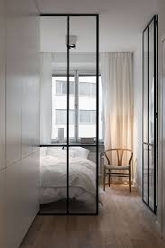 modern ceiling to floor metal frame glass doors internal