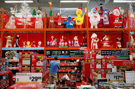 Customers browse Christmas decorations while shopping at a Home Depot Inc.  store in Torrance,