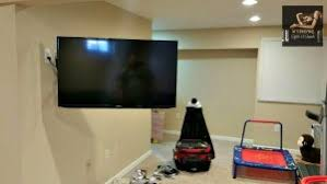flat screen tv on wall with surround sound. 65inch led tv mounted on a full motion bracket \u0026 ir senor and all wires concealed in wall. manalapan nj playroom. cable box audio/video components flat screen tv wall with surround sound