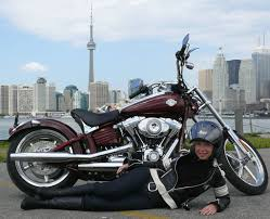 rollicking on harley davidson rocker c softail woman motorcycle