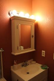 cabinet light bathroom lights how to light above cine cabinet non recessed design cool