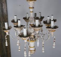 twelve light italian wood painted and iron chandelier
