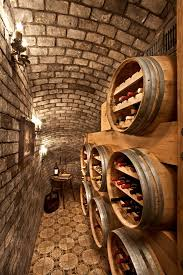 wine barrel chandelier wine cellar mediterranean with brick ceiling brick wall candle sconces double