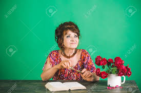 writer and poet granny read fairytale old woman reading book with gles at flowers happy old lady or grandmother