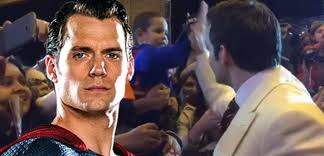 Henry Cavill Autographs A Young Fan's Superman Costume