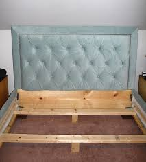 image of diy bed frame with headboard cork pillows lamps