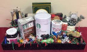 all of the items in this gift basket are for the whole family to share everything is placed on a holiday serving tray