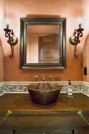 bathroom vanity wall sconces. wood framed bathroom wall mirrors with two sconces above single sink vanity