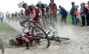 Image result for paris roubaix riding on cobbles in the rain