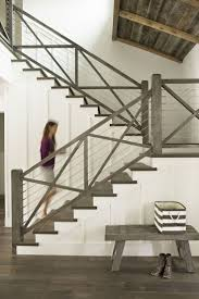 Very cool stair railing! Love the board and batten design; and the creamy  white walls with the weathered grey wood tones is so serene. newport beach:  a ...