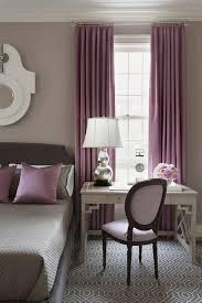 Gray and Purple bedroom features walls painted warm gray lined with a gray  bed dressed in