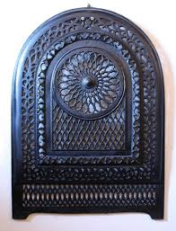 this is a magnificent antique cast iron arched fireplace cover dating from the early 1900 s it features a large circular design in the center