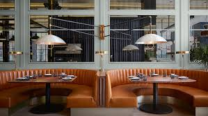chicago restaurant in former printing house features terracotta accents