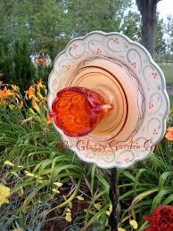 diy glass plate garden art more garden flower art glass garden art