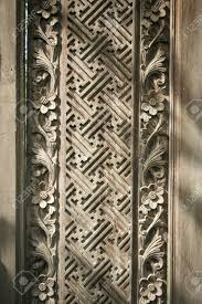 carved geometric flower patterns in wooden wall panel in ubud bali indonesia stock photo 18976657 on indonesian wooden wall art with carved geometric flower patterns in wooden wall panel in ubud