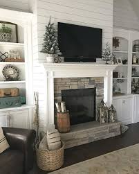 white shiplap fireplace w tv built in bookcase