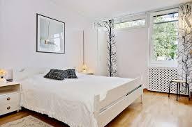 scandinavian design bedroom furniture wooden. Bedroom:Chic Scandinavian Bedroom Decor With White Bedsheet And Textured Wood Floor Also Glass Frame Design Furniture Wooden
